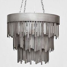 The Douglas Chandelier, a unique design from Made Goods, showcases fringed metal strips finished in aged silver. This unusual lighting accessory will make a positive bold statement wherever it is used in the home or office.