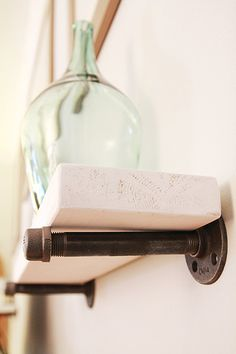DIY shelf with galvanized hardware and a plank of wood. Maybe in the basement bathroom to maximize space and maintain a masculine man cave-esque atmosphere Diy Home Furniture, Pipe Furniture, Diy Home Decor, Floating Shelf With Drawer, Floating Shelves, Diy Pipe Shelves, Diy Shelving, Creation Deco, Industrial Shelving