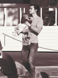 Taecyeon with a baby.  I think it's my dream come true lol