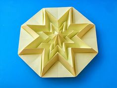 Origami: Stella infinita - Infinity Star. From an octagon from a sheet of paper copy, 21 x 21cm. Designed and folded by Francesco Guarnieri, July 2013. Instructions, CP.