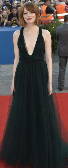 Emma Stone in Valentino paired with EF Collection jewels and Jimmy Choo heels attends the 'Birdman' premiere during the opening ceremony for the 2014 Venice Film Festival. #bestdressed