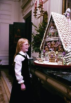 Chef Hans Raffert's A-frame gingerbread houses got bigger and more elaborate every year. Amy Carter's smile expresses a child's sense of wonder at the sugary creation in 1977.