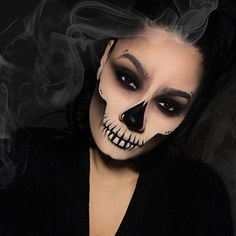 """The Halloween looks have officially started 👻💀🕷🎃🙌🏼 Skull inspired by @jordanliberty Products used . @fentybeauty foundation in 180 @tartecosmetics shape tape in light @morphebrushes Jaclyn hill palette @stilacosmetics stay all day liner @benefitcosmetics precisely my brow pencil """"5"""" • #njmua #newjerseymua #newjerseymakeupartist #njmakeupartist #njmakeupartists #halloweencostume #halloween #halloweenmakeup #skull #skullmakeup #smokeyeye #smoke"""
