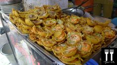 Banh khot is a delicious street food in Vietnam. It's like a mini size savory pancake with pork or shrimp toppings . Extremely Addictive!