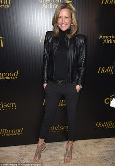 She's got the power: GMA's Lara Spencer stood out in a black leather jacket and cropped pants with fringed beige heels and a Chanel designer belt