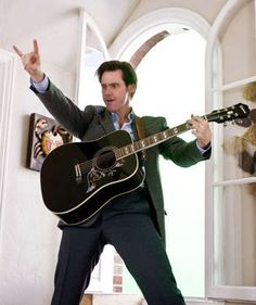"""Jim Carey Horns Up with a Black Epiphone Hummingbird in """"Yes Man"""""""