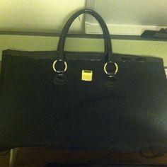 Simply Vera by Vera Wang handbag Black printed Simply Vera by Vera Wang handbag.  Patent detailing, black lining and monogram exterior. Simply Vera Vera Wang Bags