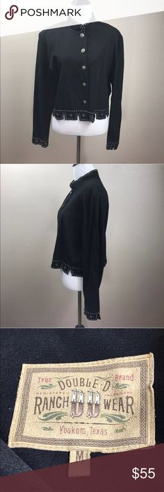 Double D Ranch Black Jacket Med Silver Medallion Double D Ranch Wear Black Jacket Medium Mandarin Collar Embellished Long Sleeve  Size: Medium  Color: Black  Design: Embellished Blazer  Neckline: Mandarin  Sleeves: Long Sleeve (25 inches)  Materials: 100% Rayong  Measurements: Armpit to armpit- 41 inches, Length- 20 inches (approximate measurements)    Condition: Great Preowned condition. No stains.  The jacket is missing one silver medallion on the bottom left side.  There is a tiny hole…