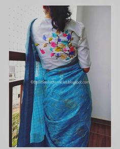 An embroidered white blouse paired with a blue cotton saree