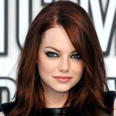 Dark luscious auburn color with her light eyes.