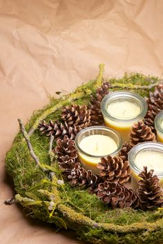 Advent wreath from moss, twigs and pinecones - can make with stuff you pick up in your back yard.