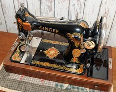 Singer 128 sewing machine from 1929.  This is very similar to the one Beck found at Goodwill, only it's a treadle with table/drawers/extra pieces - for $79 June, 2013.......