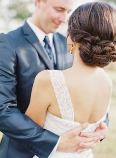 Bridal Wedding Hair -- Let the bottom down for a half-up do during the reception if you like. (BONUS: keeping everything pinned up through the ceremony means that the curls will keep longer once you do let them down.) I love these lace straps on her dress, too!