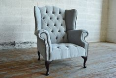 Modern British handmade Lancaster Chesterfield wing back Chair, shown in silver Naples Velvet with contrasting black deep buttoning. High back | Abode Sofas