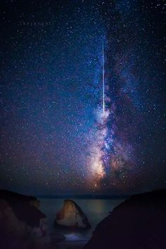Perseids Meteor shower passing in front of the Milky Way at Shark Fin Cove in Santa Cruz County byEngel Ching - sfgate