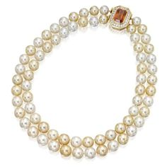 8 Karat Gold, Cultured Pearl, Orange Sapphire and Diamond Necklace, Harry Winston The double-strand necklace composed of cultured pearls measuring approximately 13.5 to 11.0 mm., completed by a gold clasp set with an emerald-cut orange sapphire weighing approximately 22.00 carats, framed by round diamonds. | sotheby's n08732lot5zfsden