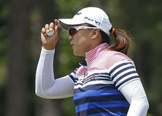 Amy Yang, of South Korea, tips her hat after making a putt on the fifth hole during the third round of the U.S. Women's Open golf tournament in Pinehurst, N.C., Saturday, June 21, 2014. (AP Photo/John Bazemore) ▼21Jun2014AP|Wie holds share of lead at US Women's Open http://bigstory.ap.org/article/wie-holds-share-lead-us-womens-open #US_Womens_Open_Championship_2014