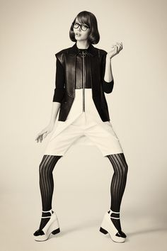 Vest, tunic, shorts-Alexander Wang, sweater- Marc Jacobs, tights- Falke, shoes- Robert Clergerie, glasses- Cutler and Gross.