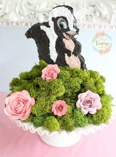 Flower pinata atop blossoms and greens from a Bambi Inspired Birthday Party on Kara's Party Ideas | KarasPartyIdeas.com (14)