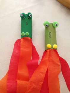 Fire-breathing dragon kid craft: toilet paper rolls, pom poms for the nostrils and eyes plus googly eyes, orange and red streamers. Blow through the roll and watch the streamers wave as though the dragon was breathing fire. Creative and interactive!