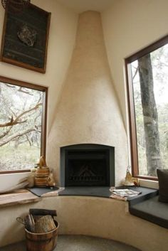 Corner, cob fireplace in a straw bale home with sitting ledge.