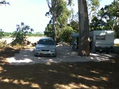 Our new home for the next 4/5 months while Pete works. Beautiful view right on the banks of the Burdiken River. This definitely has crocs. The River is dry now but in the wet season it floods over where our caravan is.