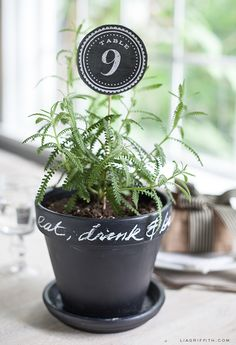 Chalkboard Style Table Numbers by Lia Griffith.  Bring the outdoors into the celebration with flowerpot centerpieces that also serve as table numbers. Download and print on a quality, strong cardstock such as Bazzill Basic's Smoothies.  Find this cardstock at more at www.cardstockshop.com.
