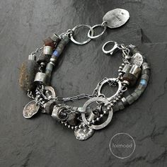 Bracelet is made of oxydized and rubbed silver 925, raw baltic amber, labradorite.  Dimensions: Stones: 3-22 mm (0,20-0,87 inches) silver elements size from 5 to 19 mm (0.20 - 0.75 inches) The whole length: approx. 8.66 inches (22 cm) Adjustable inside circuit: 7.09 and 7.48 inches (18 and 19 cm).  Weve made those bracelets project 7 years ago, it is one of our most popular patterns. If you want, we can prepare a bracelet in other colors (or use other stones). The last photograph presents…