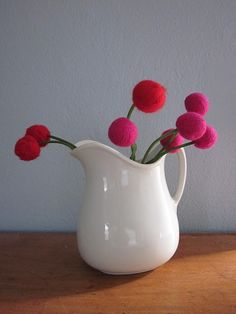 Felted flowers... made from yarn boiled in water! Totally awesome and totally doable!