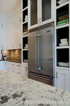 Open shelves around fridge - veranda interiors