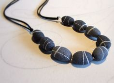 Long Stone necklace made of Paper Mache, closed with ribbon soft black alcantara  A unique and original line of jewelry inspired by the beauty of the stones as well as nature designed them.