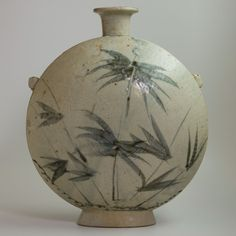View 1: Korean Moon Flask - This grey-white moon flask with flattened sides depicts bamboo on one side, and a bird, cicada and flower on the other. It's delicately decorated surface is pleasing to the eye and is also appreciated for its thin rimmed opening and base