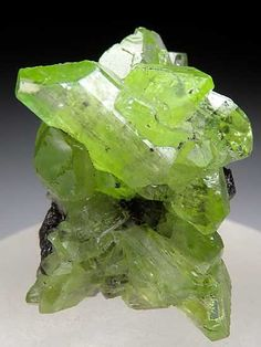 Diopside on Graphite   ©Marin Mineral Company Merelani Hills, Arusha Region, Tanzania.