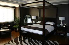 dark colored bedrooms | Dark chocolate walls, wood canopy bed, white bedding, wood nightstands ...
