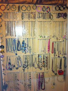 To keep my jewerly organized, I used peg board, with a 1x1 board on the back and painted it the same color as the wall. I put tea cup hooks around the outside for broaches and peg board hooks for necklaces & bracelets.  Since it is located behind a door, I put a door stop on the board.