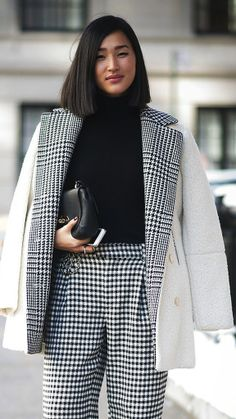 A dual patterned outfit, with both houndstooth and plaid, is pulled together with the same neutral tones. www.justblynk.com