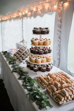 Wedding dessert display - cupcake tower, mini cheesecakes and cannolis {Rockhill Studio}