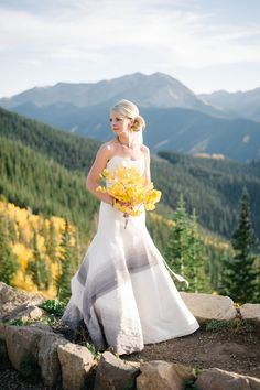 Trumpet wedding dress, gray ombre stripe, strapless, yellow leaf bouquet, fall wedding in Aspen // Lisa Anne Photography