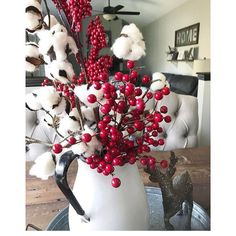 Cotton stems and cranberries for Dining room table centerpiece for the holidays. Perfect for Christmas and winter. Rustic glam house, fixer upper inspired. Home decor.