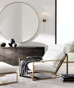 Decorating with Mirrors. An oversized round mirror enhances the minimalist style of this Living Room.