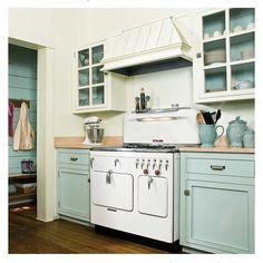 This is not my kitchen, but I pinned it on #pinterest because I think it's lovely. I have been debating for over a year and a half now, about whether or not to paint my kitchen just like this. Blue on the bottom, white on top, blue insets. The cabinets in my kitchen are original (1926), floors are hardwood, counters are copper, and appliances are white. What do y'all think? Should I at least try it? #kitchenideas #wytheblue #benjaminmoore #antiquekitchen #kitchencabinets