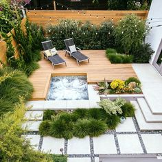 A rock wall fringed with Berkeley sedge separates a lower paved patio from a raised redwood deck and hot tub. The level change makes the small backyard appear larger. (Patio Step From House) Backyard Patio Designs, Small Backyard Landscaping, Patio Ideas, Landscaping Ideas, Small Patio, Small Decks, Pool Ideas, Desert Backyard, Pavers Ideas