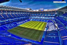 Go to a Real Madrid soccer game at the Santiago Bernabéu stadium