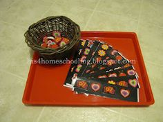 tot tray- valentine erasers (from the Dollar Tree) and pattern strips