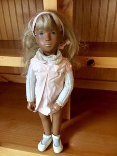 Beautiful, 1970's brunette Sasha doll with a can (but its kind of beat up). She is dressed in a blue corduroy dress with bloomers and blue shoes. Included are several other outfits including: red hooded coat, light pink summer outfit, plaid skirt with white blouse and bloomers, black tall boots, socks, white and brown shoes and undershirt, orange party dress, a red pantsuit, jeans with jacket embroidered with flowers, and a white long dress. Some of these items were hand-made by my mum. ...