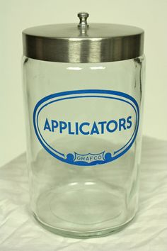 """American vintage """"Applicators"""" Jar by Grafco (founded in Made of solid glass with a stainless steel lid, this classic piece of glassware harks fr. Antique Glass, Taiwan, Workshop, Mid Century, Jar, Stainless Steel, Logo, Retro, Bathroom"""