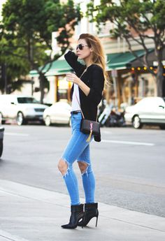 Stiletto boots, ripped denim, black blazer, and a white tee. Don't forget a gorgeous purse.