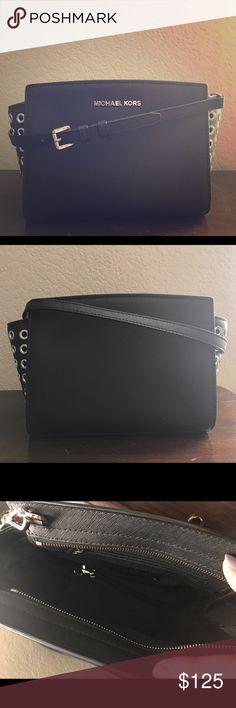 "Michael Michael Kors Selma Grommet Crossbody Authentic Medium size Selma grommet crossbody in saffiano leather. Gently used. Dimensions: 11.5""W x 6.7""H x 4.3""D. Adjustable strap 21.5""-23.5"". MICHAEL Michael Kors Bags Crossbody Bags"