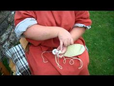 Roman textiles - how to make mittens and socks by single needle knitting or naal binding at Chedworth Roman Villa.