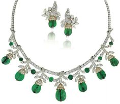 Emerald/diamond necklace and earrings, Van Cleef and Arpels. Circa 1960's. Via Diamonds in the Library.